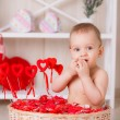 Little boy sits among candies — Stock Photo #38640823
