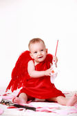 Cheerful boy dressed as cupid — Stock Photo