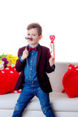 Boy with mustache and heart — Stock Photo