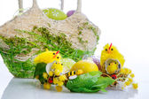 Basket with eggs and easter decoration — Stock Photo