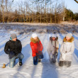 Stock Photo: Children sculpt snowballs