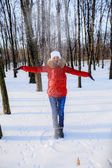 Girl throwing snow — Stock fotografie