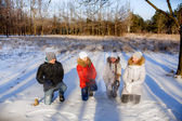 Children sculpt snowballs — Stock Photo
