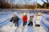 Children sculpt snowballs — Stock Photo