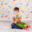 Boy sitting with tulips — Stock Photo #41381661