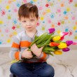Boy with tulips — Stock Photo #41381669