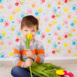 Boy sitting with tulips — Stock Photo #41381671