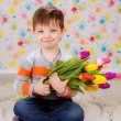 Boy with tulips — Stock Photo
