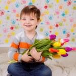 Boy with tulips — Stock Photo #41381677