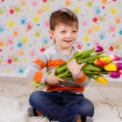 Boy with tulips — Stock Photo #41381705