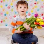 Boy with tulips — Stock Photo #41381711