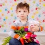 Boy with tulips — Stock Photo #41381777
