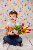Boy with tulips — Stock Photo