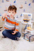 Small boy and ship — Stock Photo