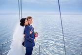 Happy newlyweds on yacht — Stock Photo
