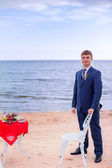 Groom on beach — Foto Stock