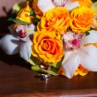 Wedding bouquet and a ring — Stock Photo