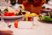 Holiday Table Setting with blank card — Stock Photo