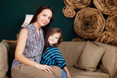 Girl with her mother in the room — Stock Photo