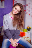 Teenager sitting in a stylish room — Stock Photo
