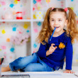 Happy little girl draws with colored pencils — Stock Photo #43543033