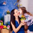 Daughter kissing mother — Stock Photo #43543189