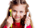 Little girl with a toothbrush. — Stock Photo