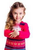 маленькая девочка, держа сосуд из конфет — Стоковое фото