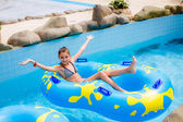 Girl in on double  inflatable ring — Stock Photo