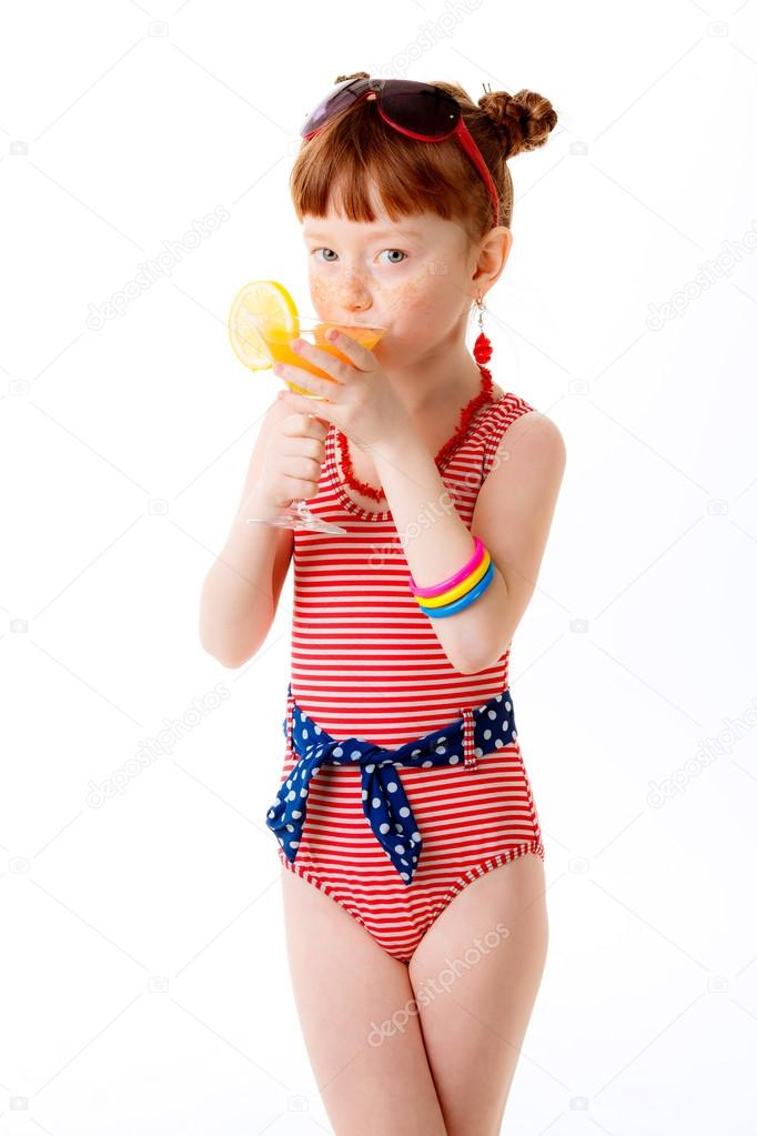 little girl in a bathing suit drinking cocktail stock
