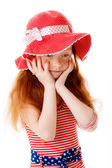 Little girl in bathing suit and beach hat — Stock fotografie