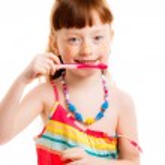 Little girl brushing her teeth — Stock Photo #44130993