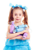 Girl in blue dress holding candies — Stok fotoğraf