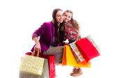 Mother and daughter with bags — Stock Photo