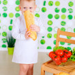Small boy holds a loaf — Stock Photo #44424155