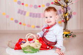 Boy  in ukrainian suit with Easter eggs — Stock Photo