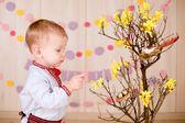 Little boy  near decorative Easter tree — Stock Photo