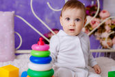 Little girl playing with toys — Stock Photo