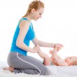 Mother doing foot massage — Stock Photo