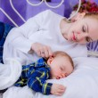 Mother lies near her newborn baby — Stock Photo #45179093