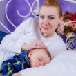 Mother lies near her newborn baby — Stock Photo #45179113