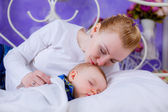 Mother lies near her newborn baby — Stock Photo