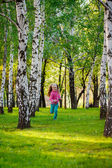 Happy girl running in the park. — Stock Photo