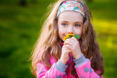 Pretty girl  smelling dandelions — Foto Stock