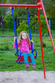 Girl ride on a swing — Stock Photo