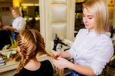 Hairdresser make braids — Stock Photo