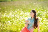 Girl resting on the glade — Stock Photo