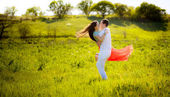 Whizzing couple on meadow — Stock Photo