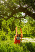 Girl ride on a swing outdoors — Stockfoto