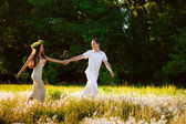 Couple running on a field — Stock Photo